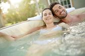 Couple enjoying relaxing time in hot tub water poster
