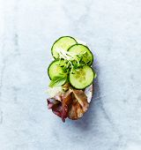 Healthy open sandwich with soft cheese, cucumber, red lettuce and herbs. Flat lay. Healthy food conc poster