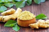 Ginger Root And Ginger Powder In A Wooden Bowl poster
