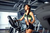 Young Fitness Woman Doing Cardio Exercises At The Gym Running On A Treadmill. Female Runner Training poster