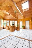 Wooden Wall Sun Room Interior with Natural Wicker Furniture, Ceramic  Tile floor