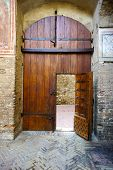 Medieval Wooden Door in Tuscany, Italy