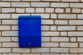 Blue Mailbox For Letters And Newspapers On A Brick Wall In Belarus poster