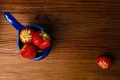 Fresh Strawberries In Blue Bowl On Old Wooden Vintage Table. Red Juicy Strawberry poster