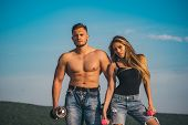 Workout On Fresh Air. Workout Of Day. Muscular Man And Woman After Workout On Blue Sky. Workout Make poster