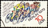 Group Of Young Cyclists On Post Stamp