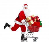 Happy running Santa Claus with a shopping cart. Christmas. Isolated on white background.