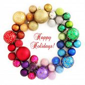 Colorful Christmas wreath decoration from rainbow color baubles on white background