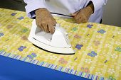 Woman ironing fabric.