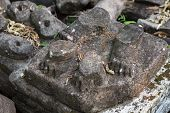 Ancient Stone Ruin In Angkor Wat Temple. Animal Paw Statue Debris Closeup. Khmer Heritage Temple Rui poster