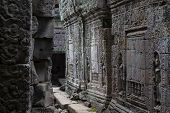 Ancient Stone Ruin In Angkor Wat Temple. Carved Stone Bas-relief Gallery. Khmer Kingdom Heritage Rui poster