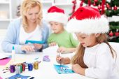 image of card-making  - Family making seasonal greeting cards together at christmas time - JPG