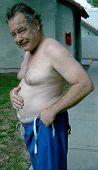 Man Patting His Big Belly