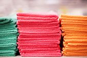 Stacks Of Colorful Towels For A Shower Or A Hotel. Pile Of Towels poster