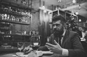 Постер, плакат: Meeting At The Restaurant Bearded Man In Restaurant With Companion Business On Go And Communicatio
