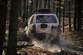 Competition Of Off-road Cars. Dirty Offroad Car With Fall Forest On Background On Sunny Autumn Day.  poster