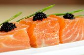 Salmon Slices with black tobiko caviar