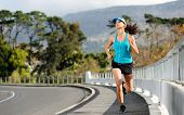 Endurance athlete training on sidewalk, running fitness marathon woman. exercise healthy lifestyle c