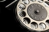stock photo of rotary dial telephone  - old vintage black  telephone detail close up - JPG