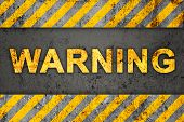 Grunge Black And Orange Pattern With Warning Text