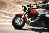 Abstract slow motion, biker riding motorbike, driver racing on the big red bike, side view, blur mov