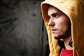 picture of hooded sweatshirt  - Young man portrait in hooded sweatshirt  - JPG