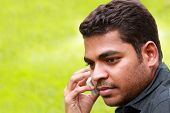 Photo Of Handsome Young Indian/south Asian Businessman Talking And Listening On Cell Phone With Copy