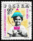 Postage stamp Poland 1968 Child Holding Symbolic Stamp