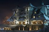 Nightshot Of Snow-Covered Ski-Resort Hotel