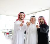 Successful and happy business arab people with thumbs up
