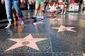 HOLLYWOOD - SEPTEMBER 4: Tourists walking on Hollywood Walk of Fame on September 4, 2011 in Hollywoo