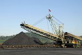 foto of coal barge  - Large Industrial Machine used to Load Coal into Trains Barges and Trucks - JPG