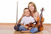 Woman And Boy With Violins
