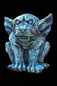 stock photo of gruesome  - A gruesome gargoyle with excellent colour and detail the original is hanging on my garden wall makes a great web image or superb print  - JPG