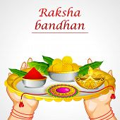 illustration of woman hand holding decorated thali for raksha bandhan