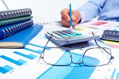 foto of accounting  - Businessman working with documents - JPG