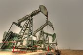foto of oilfield  - Giant steel oil pumps  - JPG