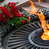 Laying Flowers At The Quenchless Flame Dedicated To Victory World War II