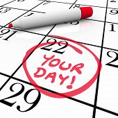The words Your Day circled on a calendar with a red marker to remind you of a special date, birthday
