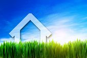 stock photo of land development  - New house perspective on green sunny field - JPG