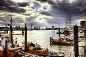 Piers, docks, tugboats and ships at Hamburg harbour