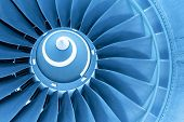 stock photo of rotor plane  - Titan blades of jet plane engine in blue light - JPG
