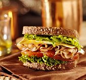 stock photo of deli  - deli meat sandwich with turkey close up shot with selective focus - JPG