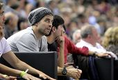 BARCELONA - APRIL, 9: Gerard Pique of FC Barcelona between audience during a Euroleague match betwee