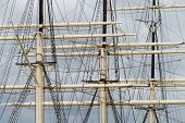 picture of yardarm  - Part of tall ship rigging against dark sky - JPG