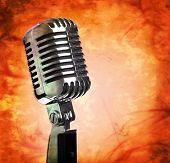 Vintage microphone on distressed grunge background