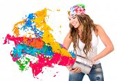 picture of hispanic  - Woman splashing colorful paint from a can  - JPG