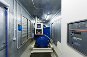 pic of generator  - Diesel generator for backup power in room with control panel - JPG