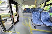 image of motor-bus  - Seats in passenger compartment of empty city bus with big windows - JPG