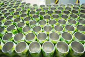 Many open aluminum cans for drinks move on conveyor at modern factory.